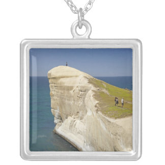 Tourists on cliff top at Tunnel Beach Silver Plated Necklace