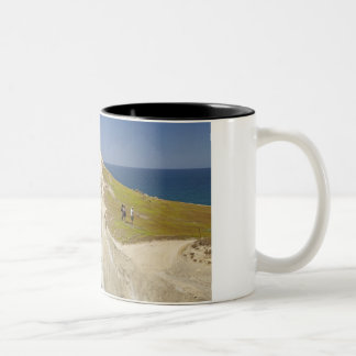 Tourists on cliff top at Tunnel Beach Two-Tone Coffee Mug