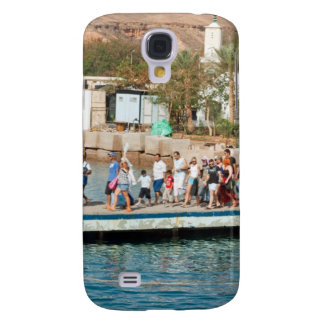 Tourists waiting to climb into a boat samsung galaxy s4 covers