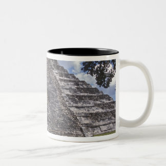Tourists walk past an unrestored side of El Two-Tone Coffee Mug