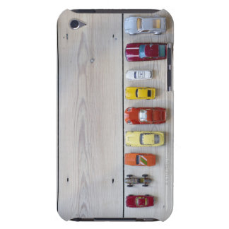 Toy cars lined up in a row on floor iPod touch cover