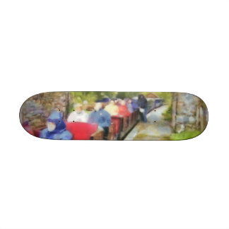 Toy train and adult passengers custom skateboard