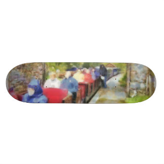 Toy train and adult passengers skate board