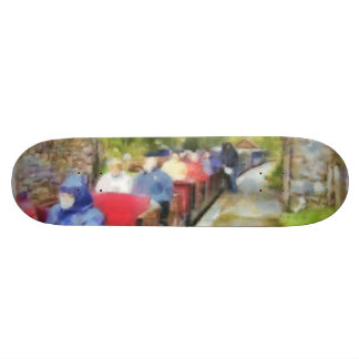 Toy train and adult passengers skate decks