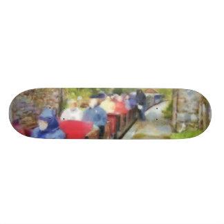 Toy train and adult passengers skateboard decks