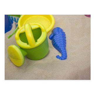 Toys on the beach postcard