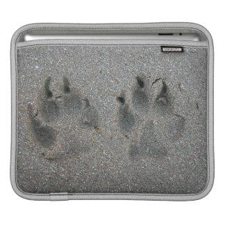 Tracks of dog in sand iPad sleeve