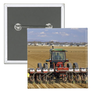 Tractor pulling a seed corn planter. 15 cm square badge