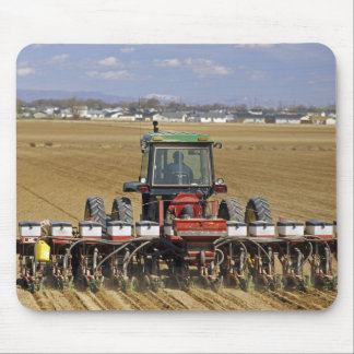 Tractor pulling a seed corn planter. mouse mat