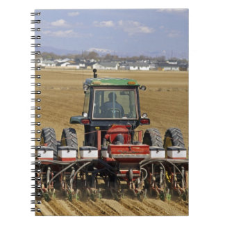 Tractor pulling a seed corn planter. notebook