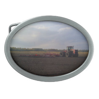 Tractor resting after tilling oval belt buckle