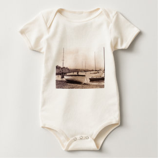 Traditional boats on the beach baby bodysuit