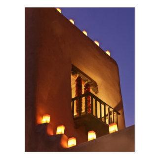 Traditional farolitos light up adobe structures 2 postcard