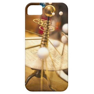 Traditional handcrafted brass orrery with the iPhone 5 cover