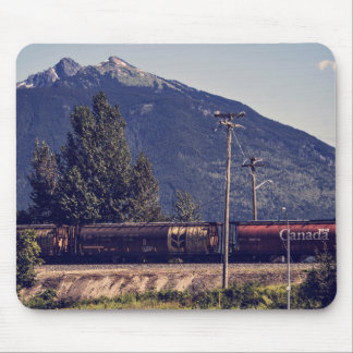 Train next to mountain mouse pad