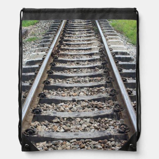 Train Tracks Along Grass Closeup Drawstring Backpacks