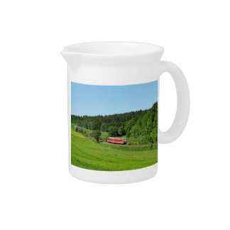 Tramcar with meadow field pitcher