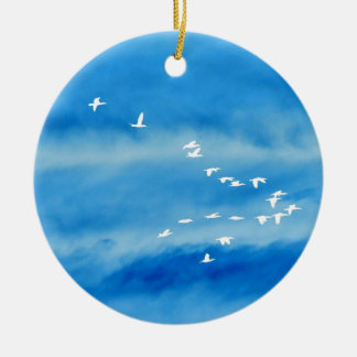 Tranquil Silhouette of Birds in Flight Christmas Ornament