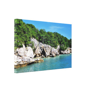 Tranquil Tropical Shoreline with Caves Canvas Print