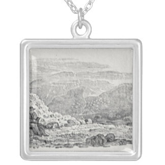 Traveller reading beneath a milestone silver plated necklace