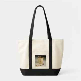 Travelling set of a knife, fork, spoon and beaker, tote bag