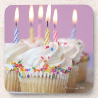 Tray of birthday cupcakes with candles coaster