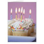 Tray of birthday cupcakes with candles greeting card