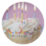 Tray of birthday cupcakes with candles plates