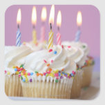 Tray of birthday cupcakes with candles square sticker
