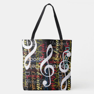 treble clefs with a pattern of colorful names tote bag