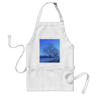 Tree covered in snow on barren landscape apron