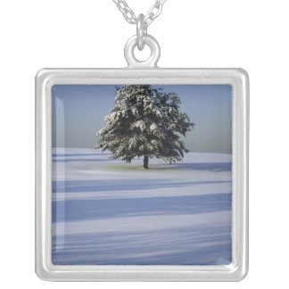 Tree in snow covered landscape silver plated necklace
