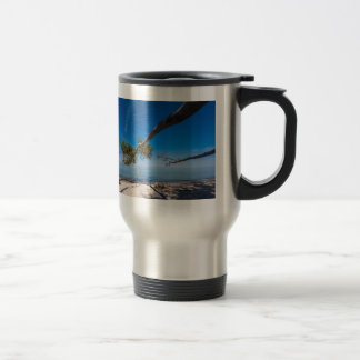 Tree on a beach on shore of the Baltic Sea Stainless Steel Travel Mug