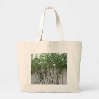 Tree Plants At White Wall Canvas Bags