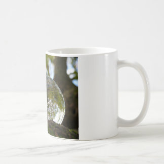 Tree seen through a crystal ball basic white mug