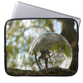 Tree seen through a crystal ball laptop computer sleeve