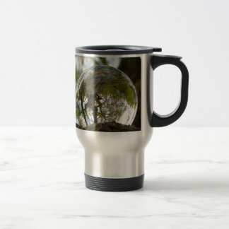 Tree seen through a crystal ball stainless steel travel mug