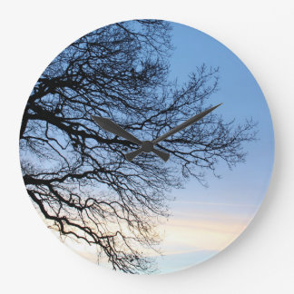 Tree Silhouette in a Blue Winters Sky Large Clock