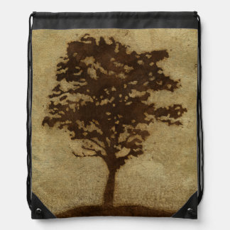 Tree Silhouette on Bronze Background Backpacks