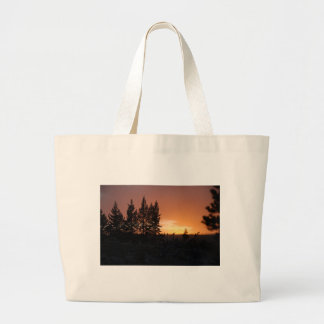 Tree Silhouettes at Sunset Canvas Bags