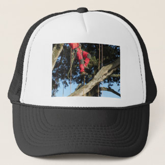 Tree surgeon lumberjack hanging from a big tree trucker hat