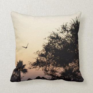trees and flying bird against florida sunset cushion