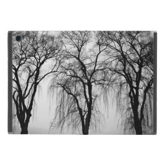 Trees silhouettes in winter covers for iPad mini