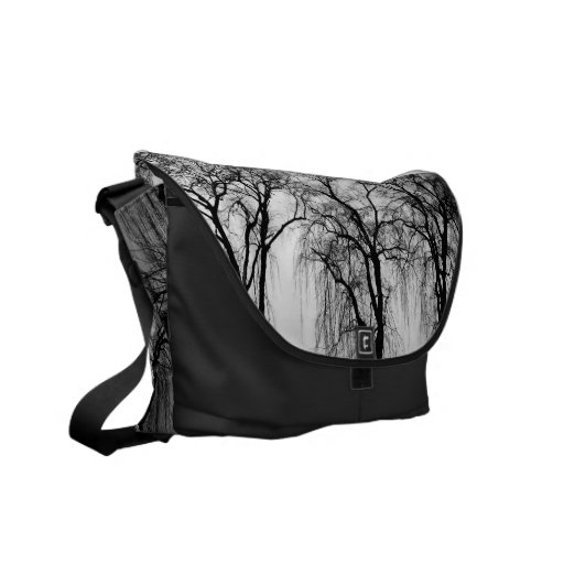 Trees silhouettes in winter messenger bags