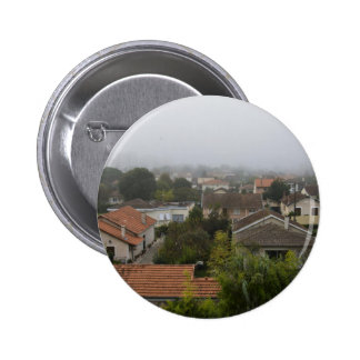 Treetops and rooftops on a cloudy day 6 cm round badge