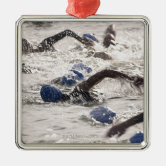 Triathletes competing in swim leg of triathlon. square metal christmas ornament