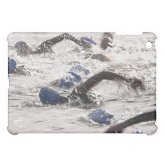 Triathletes competing in swim leg of triathlon. iPad mini cases