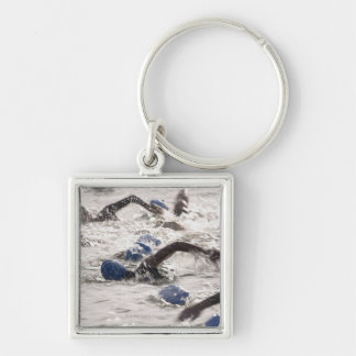 Triathletes competing in swim leg of triathlon. Silver-Colored square key ring