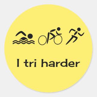 Triathlon pictograms and caption yellow classic round sticker