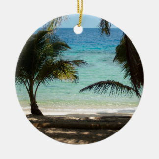 Tropical beach shaded by palms round ceramic decoration
